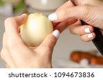 woman peeling a bow on a wooden ... | Shutterstock . vector #1094673836