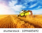 combine harvest in the golden... | Shutterstock . vector #1094685692