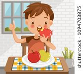 boy eating apple.sitting at the ... | Shutterstock .eps vector #1094703875
