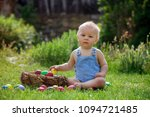 cute child  playing with little ... | Shutterstock . vector #1094721485