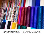 colorful cloths for sale at... | Shutterstock . vector #1094722646