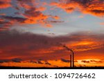 colorful magic sunset. roofs of ... | Shutterstock . vector #1094726462