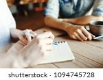 hands of woman making notes in... | Shutterstock . vector #1094745728
