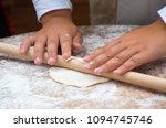 girl rolling dough with rolling ... | Shutterstock . vector #1094745746