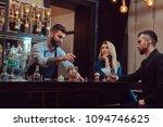 stylish brutal barman serves an ... | Shutterstock . vector #1094746625