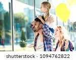 happy family walking along the... | Shutterstock . vector #1094762822