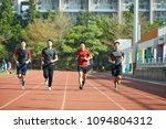 young asian adult athletes... | Shutterstock . vector #1094804312
