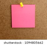 Small photo of sheet of pink paper, attached to the cork wall with a yellow thumbtack. It is used to write notes, messages, incorporate text.