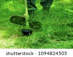 mowing weeds and grass.  | Shutterstock . vector #1094824505