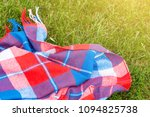 checkered bright blanket on... | Shutterstock . vector #1094825738