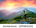 racer on the alpine stone path... | Shutterstock . vector #1094842202