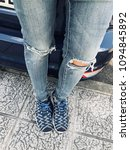 ripped jeans and blue shoes. | Shutterstock . vector #1094845892