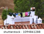 drying clothes on the roof of a ... | Shutterstock . vector #1094861288