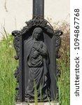 funerary metal statue of the... | Shutterstock . vector #1094867768