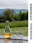 Small photo of Sweet yellow honey wine meade in beautiful mountain landscape. Ready to drink.