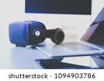virtual reality goggles on desk ... | Shutterstock . vector #1094903786