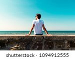 young man sitting on the... | Shutterstock . vector #1094912555