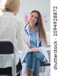 doctor and patient discussing... | Shutterstock . vector #1094928872