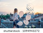 young cheerful girl holds many... | Shutterstock . vector #1094943272