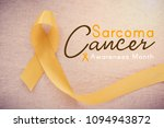 Small photo of yellow gold ribbon, world Sarcoma cancer awareness month