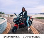 biker girl in a leather jacket... | Shutterstock . vector #1094950808