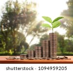 money growing from coins  | Shutterstock . vector #1094959205