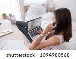 asian female freelancer talk on ... | Shutterstock . vector #1094980568