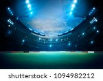 stadium in lights and flashes.... | Shutterstock . vector #1094982212