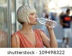 woman drinks water from bottle... | Shutterstock . vector #109498322
