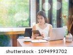 smiling business girl working... | Shutterstock . vector #1094993702