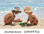 Two Little Girls Playing On The ...