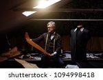 handsome mature tailor working... | Shutterstock . vector #1094998418