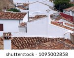 white houses roofs in the... | Shutterstock . vector #1095002858