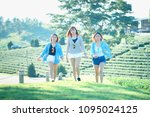three asia woman walking on... | Shutterstock . vector #1095024125