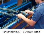 operator bending metal sheet by ... | Shutterstock . vector #1095044855