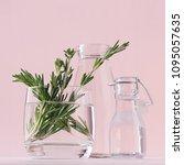 green rosemary twigs in glass... | Shutterstock . vector #1095057635