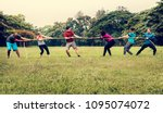 team competing in tug of war | Shutterstock . vector #1095074072