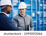 two engineers wearing hardhats... | Shutterstock . vector #1095092066