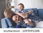 portrait of smiling father and... | Shutterstock . vector #1095092288