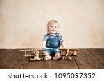 happy child playing at home....   Shutterstock . vector #1095097352