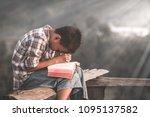 boy praying to god. | Shutterstock . vector #1095137582