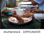 feeding the poor helping each... | Shutterstock . vector #1095146435