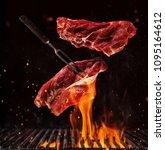 flying pieces of beef steaks...   Shutterstock . vector #1095164612