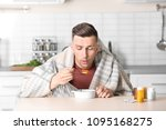 sick young man eating broth to... | Shutterstock . vector #1095168275