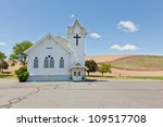 A Small White Church With A...