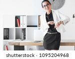 a female manager pointing at...   Shutterstock . vector #1095204968