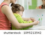 mother washing kid toddler... | Shutterstock . vector #1095213542