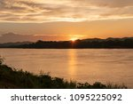 mekong river at sunset time in... | Shutterstock . vector #1095225092