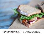 closeup of a sandwich with... | Shutterstock . vector #1095270032