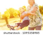 grandmother with grandson... | Shutterstock . vector #1095358985